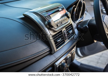 Detail of new modern car interior, Focus on stereo - stock photo