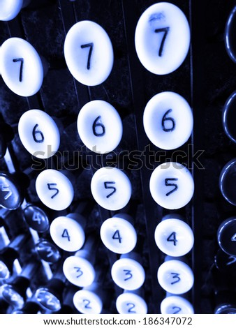 Detail of number keys on old adding machine - stock photo