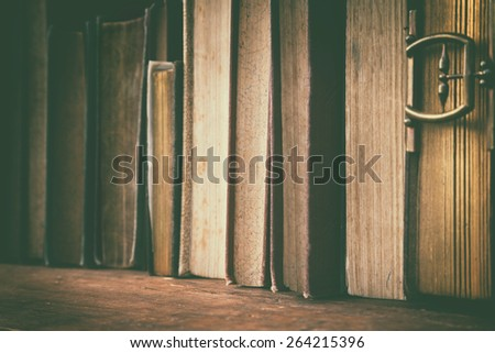 detail of old books in wooden shelf. - stock photo