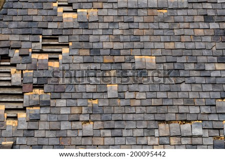 detail of old slate roof tiles