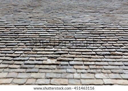 Detail of old stone roof. Tilt shift blur effect. - stock photo