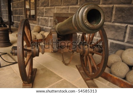 detail of old style cannon - stock photo