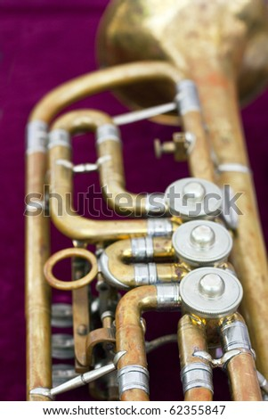 Detail of old trumpet in case with red velvet - stock photo