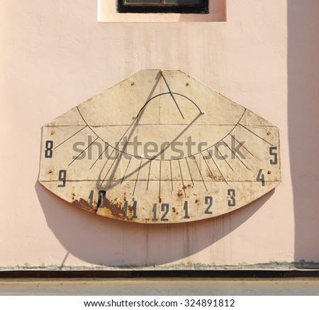 Detail of Old  Vintage Sundial on the Side of Basilica Exaltation of the Cross in CHERNIVTSI, UKRAINE - stock photo
