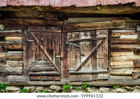 Detail of old wooden textured and weathered barn door, Vlkolinec village, Slovakia