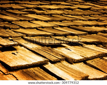 Detail of old wooden wood shingles on top of house home - stock photo