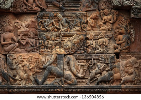 Detail of one of the multiple reliefs of the temple of Banteay Srei. Angkor. Cambodia - stock photo