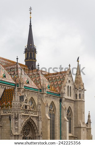 Detail of ornate carving and roof tiles on Mattias Church in Buda, Budapest, Hungary