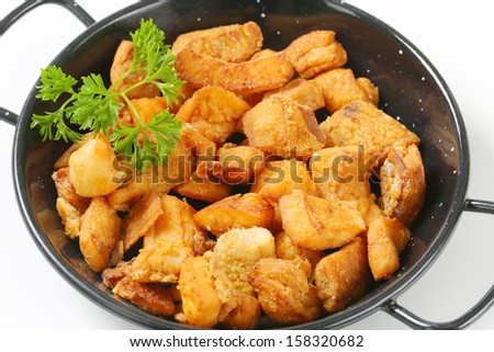 detail of pan with fried pork greaves - stock photo