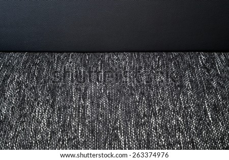 Detail of part of black and white cloth sofa - stock photo