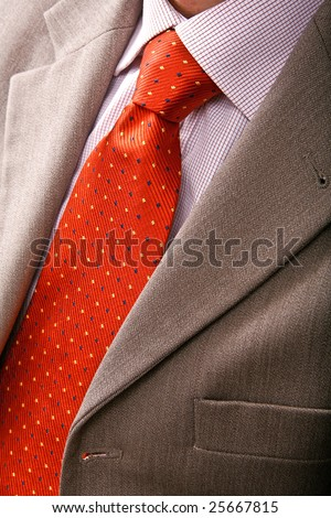 Detail of perfect business man grey suit with red tie - stock photo