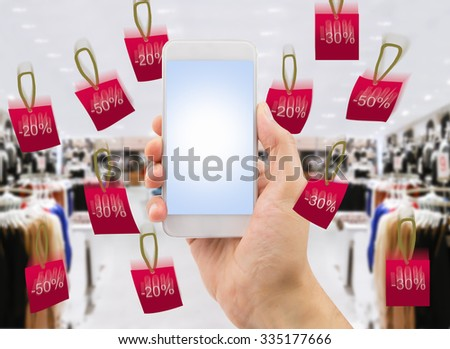 detail of person shopping by the smartphone at the store online - stock photo