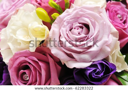 Detail of pink roses on a bride's bouquet