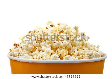 Detail of popcorn in a bucket over a white background - stock photo