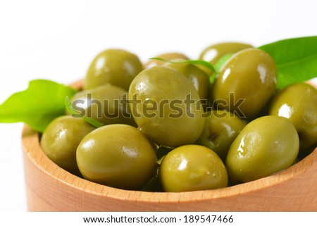 detail of portion of olives in the wooden bowl - stock photo