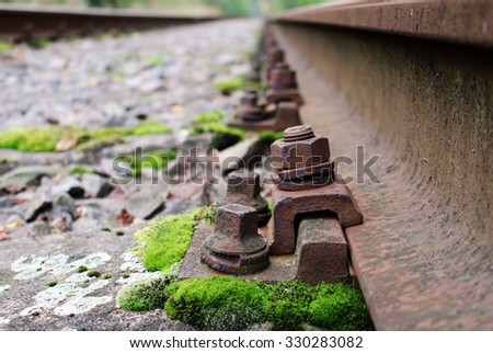 Detail of rail screw at abandoned train track