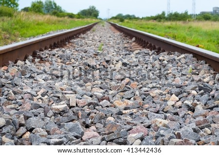 Detail of railway tracks with gravel. Selective focus - stock photo