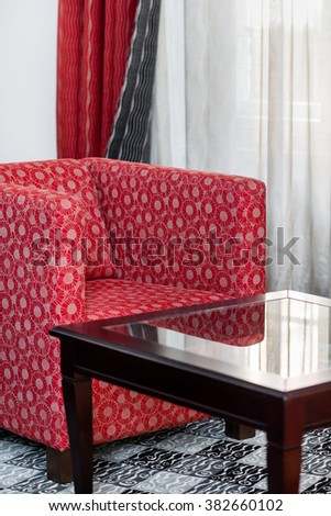 Detail of red armchair in the vintage interior - stock photo
