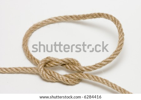 detail of reef knot on natural rope