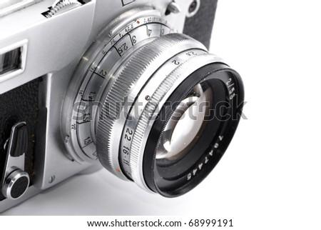 Detail of retro analog camera lens engravings isolated on white - stock photo