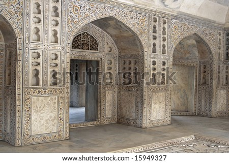 Detail of richly carved marble walls and arches decorating a Mughal Palace inside the Red Fort, Agra - stock photo