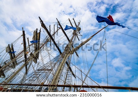 Detail of rigging of sailing ship against a blue sky. - stock photo