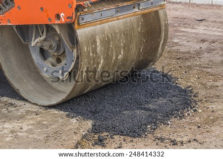Detail of road roller during road construction. Selective focus. - stock photo
