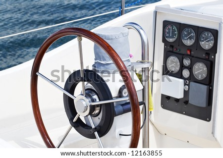 Detail of rudder and navigation instruments on a sailboat - stock photo