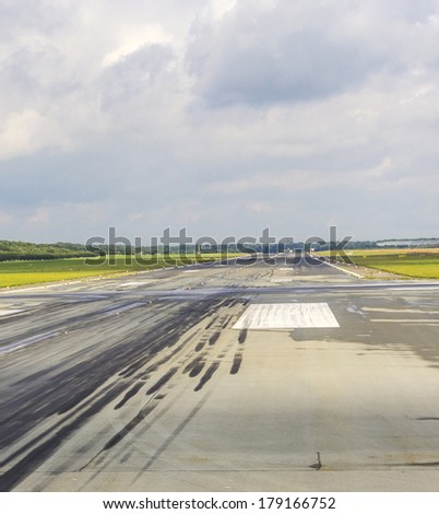 detail of runway with pattern of wheels in the touch down zone - stock photo