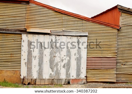Detail of Rusty Corrugated Iron texture and patterns - stock photo