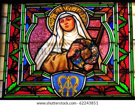 Detail of Saint Margarita from a stained glass window in a church in France. - stock photo