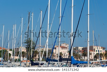 detail of several boat masts in Alghero, Sardinia - stock photo