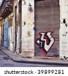 Detail of shabby building exterior with graffiti in Old Havana street - stock photo