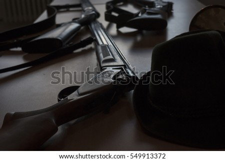 Detail of shotguns on the table