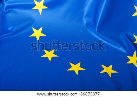 Detail of Silky Flag of Blue European Union EU Flag Drapery - stock photo