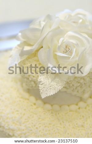 detail of simple ivory wedding cake - stock photo