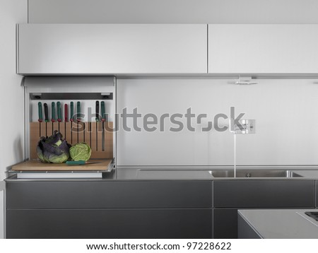 detail of sink and steel faucet in a modern kitchen - stock photo