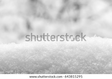 Detail of snow pile. Snow texture. Black and white.
