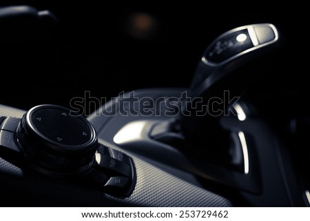 Detail of some black buttons in a car. - stock photo