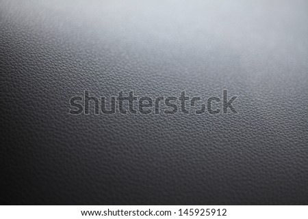 Detail of some black leather with shallow depth of field - stock photo