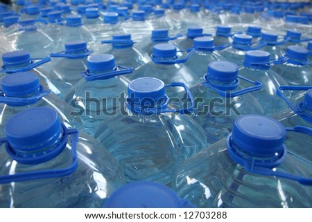 detail of stack bottled water in industry - stock photo