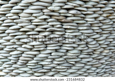 Detail of Stacked Smooth Stones Ideal for Backgrounds - stock photo