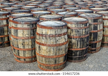 Detail of stacked whisky casks and barrels - stock photo