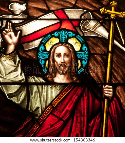 Detail of stained glass window depicting Easter resurrection of Jesus Christ, with Easter banner - stock photo