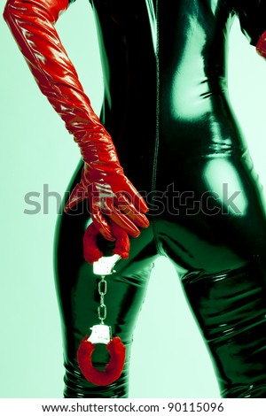 detail of standing woman with handcuffs - stock photo