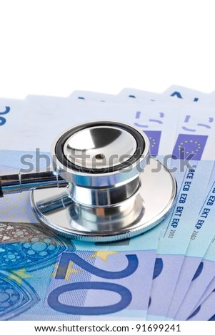 detail of stethoscope on 20-euro banknotes on white background - stock photo