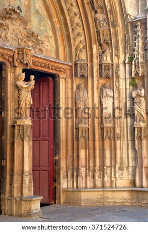 Detail of stone carvings on the Gothic gate of the Aix Cathedral, Aix-en-Provence, France - stock photo