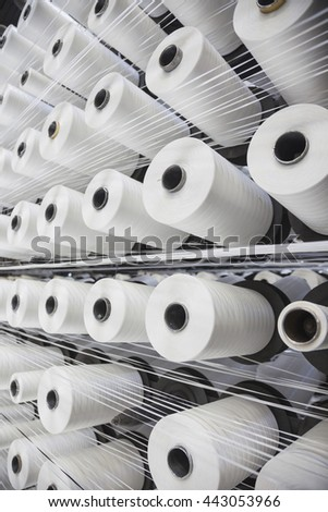 Detail of string reels in factory - stock photo