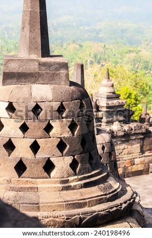 Detail of stufa at Borobudur temple in Yogyakarta, Indonesia - stock photo