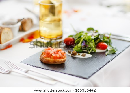 Detail of table set for wedding or another catered event dinner - stock photo